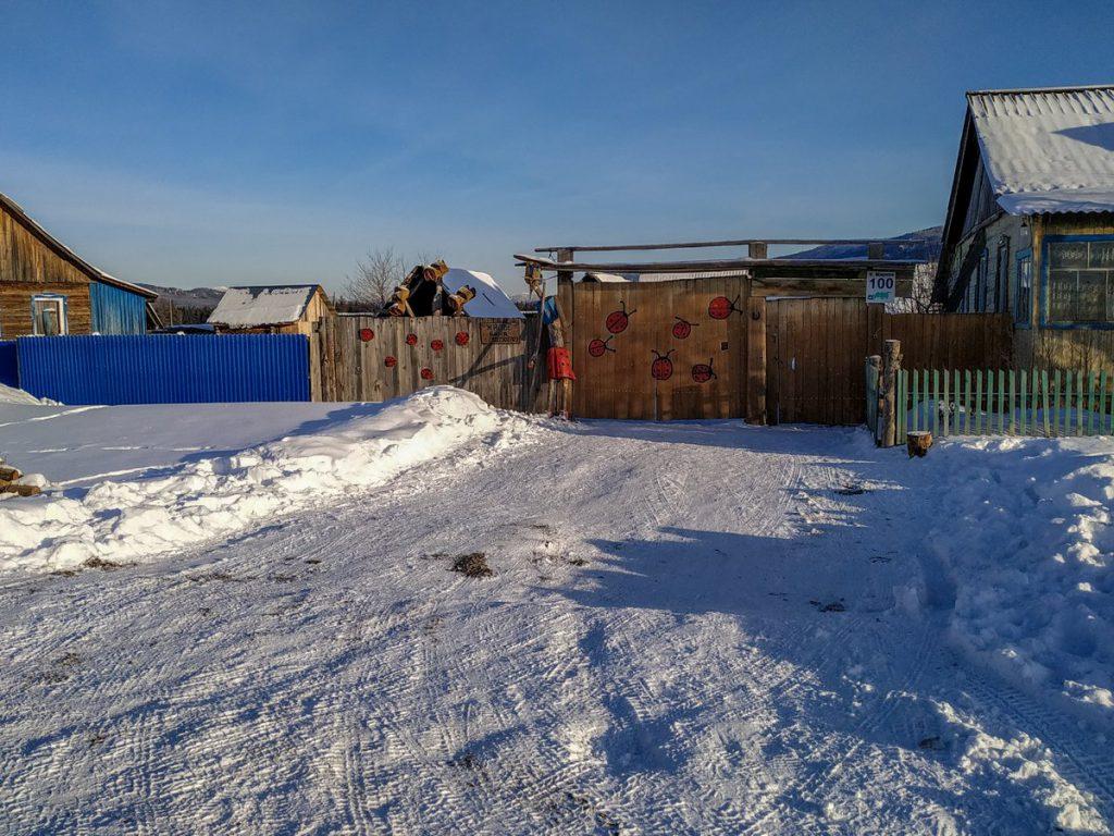Село Тюлюк, база с забором с божьими коровками